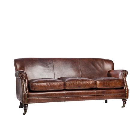Кожаная мебель: достоинства и недостатки