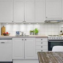 Фотография: Кухня и столовая в стиле Скандинавский, Квартира, Цвет в интерьере, Дома и квартиры, Белый, Камин – фото на InMyRoom.ru