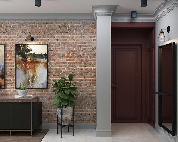 Над входной дверью в квартиру нужно было сделать короб, куда спрятались коммуникации. Просто делать его скрытым в цвет основных стен было скучно и визуально массивно. Поэтому создали своеобразный портал с дверью и все выкрасили в винный цвет.